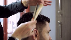 Haircut at barber's. Hairdresser shaping men's hair into a style by cutting. HD Stock Footage