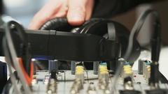 Disc Jockey Taking Headphones And Listening to Music Stock Footage