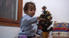 Kid disappointed with New Year Tree Stock Footage