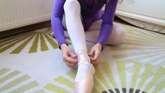 Young ballerina wearing pointe shoes 2 Stock Footage