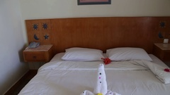 Romantic Hotel Room with Swan Towels Stock Footage