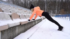 Fit woman doing push ups in the snowy stadium. Stock Footage