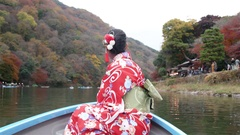 Beautiful Japanese women in Kimono riding boat in Kyoto Arashiyama Japan  Stock Footage