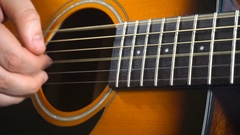 Man playing on acoustic guitar Stock Footage