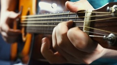 Man playing on acoustic guitar Arkistovideo