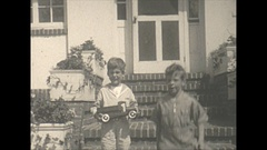 Vintage 16mm film, 1927 Vetnor NJ, little boys playing with toy truck Stock Footage