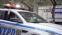 NYPD police officers in car driving on Park Avenue flashing turret lights NYC Stock Footage