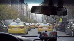 Taxi cabs driving inside passenger view Park Ave MetLife Building Manhattan NYC Stock Footage
