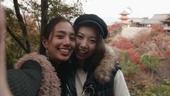 POV selfie two women at kiyomizudera temple in Kyoto Japan  Stock Footage