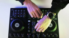 Disc Jockey's Hands While He Uses DJ Mixer Stock Footage