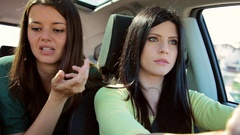 Beautiful women arguing in car while driving closeup Stock Footage