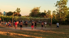 People Play Volleyball on Country Sports Ground at Sunset Stock Footage