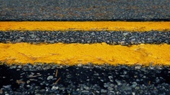 Passing Yellow Road Lines Closeup Stock Footage
