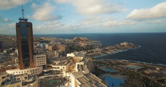 Aerial shot by a business tower in Malta Europe Stock Footage
