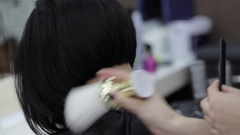 Hairdresser cutting client's hair in salon and using talc closeup. Stock Footage
