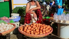 Closeup Woman in Hat Sells Eggs at Street Market in Vietnam Stock Footage
