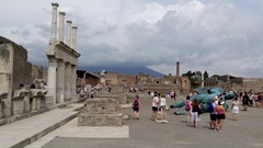 Tourists visit the ancient Roman forum of the ruins of Pompeii Stock Footage