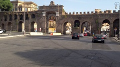 Traffic in front of the famous Porta San Giovanni Stock Footage