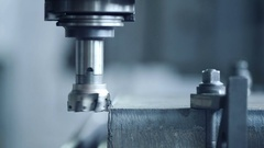 CNC milling machine produces metal detail on factory Stock Footage
