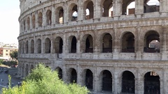 Tourists walk next to the Colosseum in Rome Stock Footage