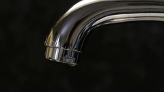 Water dripping from a faucet Stock Footage