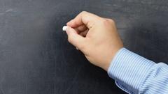 Sale text handwritten on blackboard or chalkboard by businessman Stock Footage
