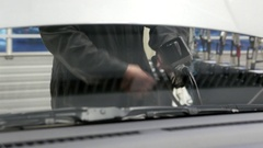 Car mechanic pouring new oil to engine at Canadian tire store Stock Footage