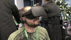 A man watches 360 degree video in virtual reality using Oculus Rift Stock Footage