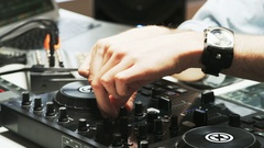 Disc Jockey's Hands While He Changes Settings of the Sound Control System Stock Footage