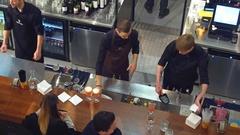 WARSAW, POLAND - DECEMBER, 22, 2016. Barmen making cocktails at the bar. 4K view Stock Footage