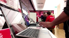 People playing new computer at Microsoft store in Burnaby BC Canada Stock Footage