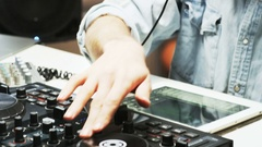 Disc Jockey's Hands and Face While He Changes Settings of the Sound Control Stock Footage
