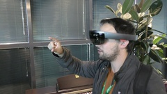 A man hunts bugs with Microsoft HoloLens, a self-contained holographic computer Stock Footage