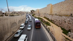 Heavy traffic on main road over bridge in Jerusalem old city Stock Footage