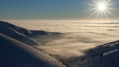 Winter landscape in Carpathian mountains. Beutiful sunset above the clouds Stock Footage