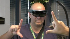 A man signals CLICK to Microsoft HoloLens, a self-contained holographic computer Stock Footage