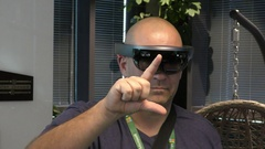 A man signals START to Microsoft HoloLens, a self-contained holographic computer Stock Footage