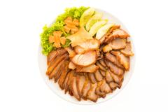 Roasted bbq red pork with sweet sauce in chinese food style in white plate Stock Photos