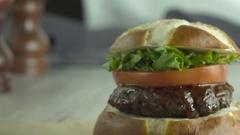 Juicy Hero Hamburger on Pretzel Bun. Stock Footage