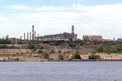 Panoramic view of ironworks on river coastline Stock Photos