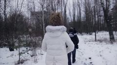 Girl walk at Chernobyl winter roads Stock Footage