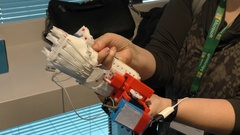 A woman demonstrates a 3D printed, bionic hand to the help of amputated persons Stock Footage