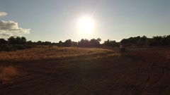 Motorally at sunset. About extreme sports, adrenaline, dust, motorcycle, motorcy Stock Footage