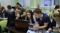 Team of students taking an active part in competition of young professionals Stock Footage