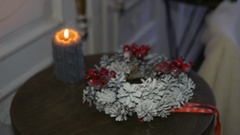 Christmas wreath and burning candle on the table. Soon holiday Stock Footage