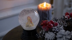 Christmas decorations. Shiny magical crystal ball. Snow falls on the city Stock Footage