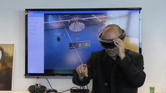 A man interacts with Microsoft HoloLens, a self-contained holographic computer Stock Footage
