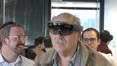 Entrepreneur and investor Yossi Vardi interacts with Microsoft HoloLens Stock Footage