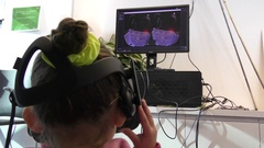 A child watches 360 degree video in virtual reality using Oculus Rift Stock Footage