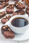 Homemade dark chocolate biscotti cookies with almonds, covered with melted .. Stock Photos